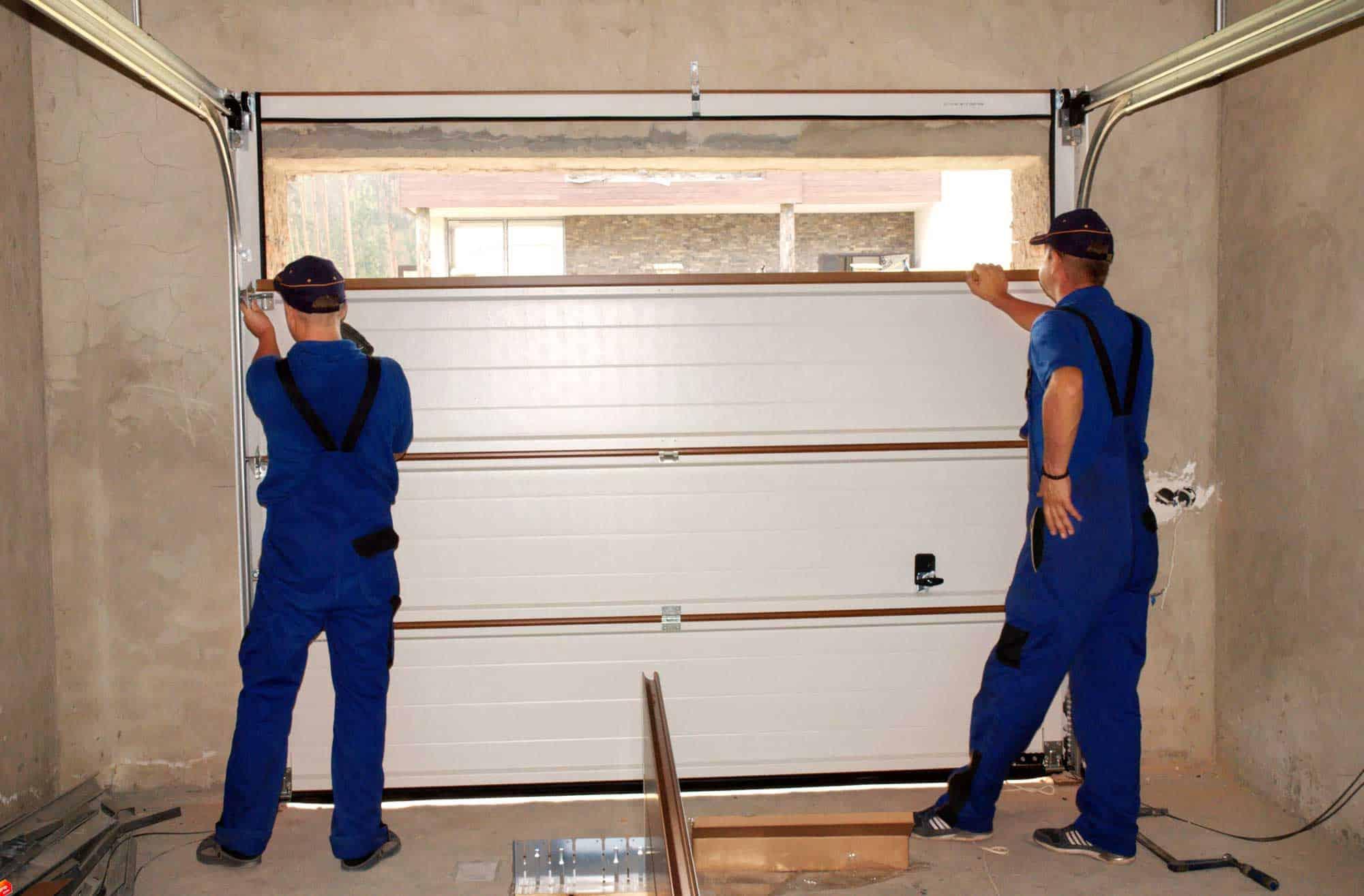 2 men installing garage door