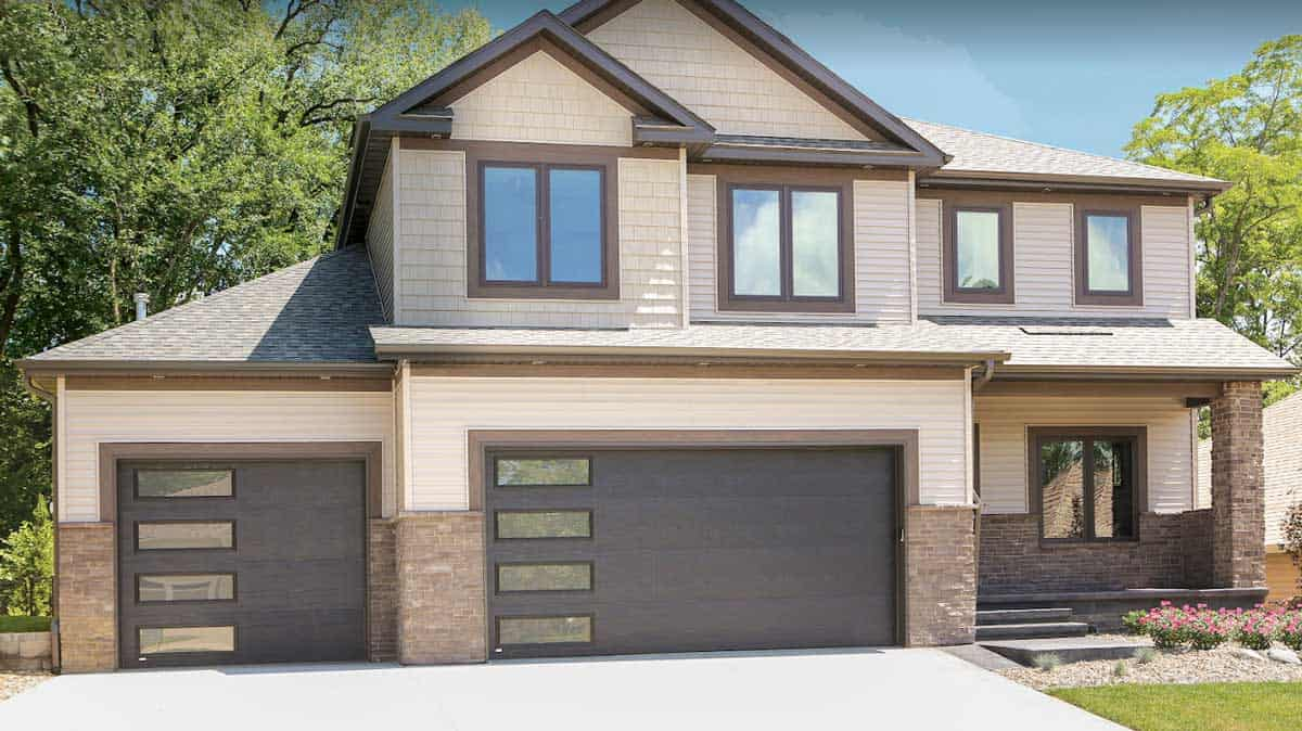 modern garage door with mirrors on large house