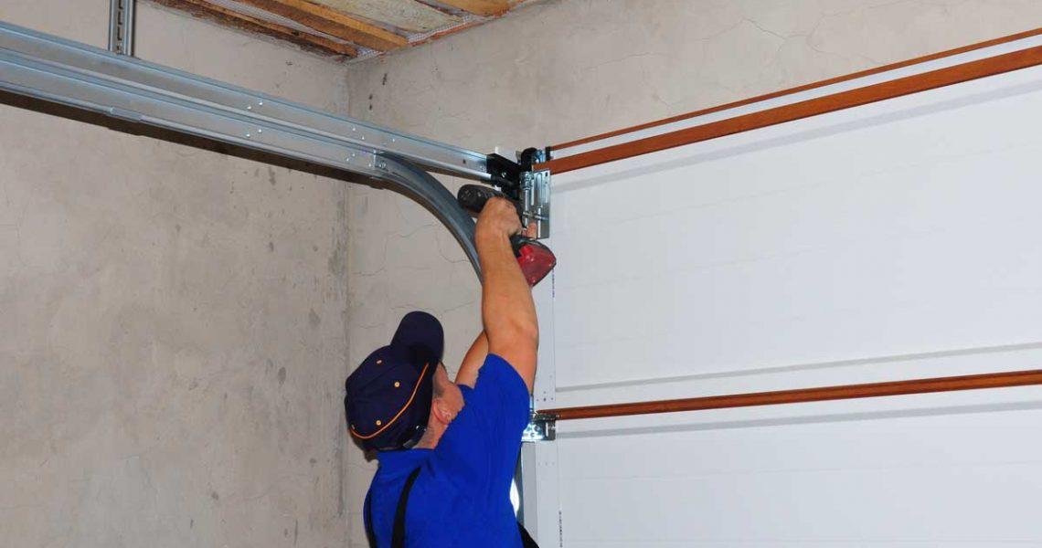person repairing inside garage door