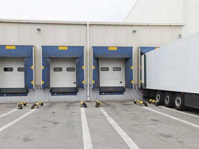 semi backed up to loading dock 5 bays